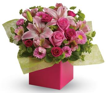 Softest Whispers. Description: Any time is the perfect time to send a pink-me-up with this lush arrangement of lilies, roses and asters!