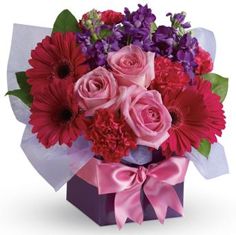 Simply Stunning. Description: A stunning study in contrasts, this fabulously feminine arrangement mixes pale pink roses with hot pink gerberas and purple stock. A simple way to show you care!