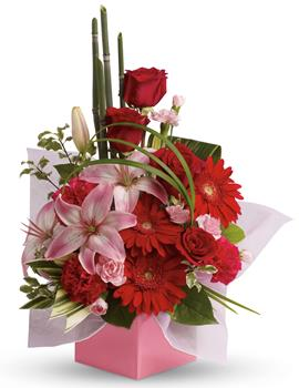 Artistic Expression. Description: The art of love. Take their breath away with this uniquely sculptural arrangement of lilies, gerberas and canes of bamboo-like equisetum.