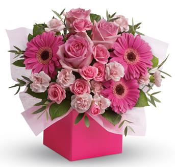 Think Pink. Description: Looking to pamper someone special? Think pink! Hot pink gerbera mix with soft pink roses and mini carnations in this fabulously fun arrangement.