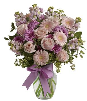 Heaven Scent. Description: Simply divine. Send them a slice of heaven with this lavish presentation of roses, gerberas and stock in a vase.