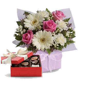 Sweet Thoughts. Description: Share your sweet thoughts with this lady like arrangement of pure white gerberas, candy pink roses and soft white carnations.