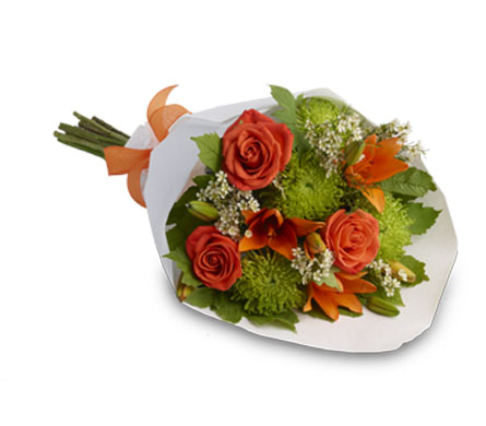 A Touch of Class. Description: A beautiful, classic bouquet presented in a decorative bag.