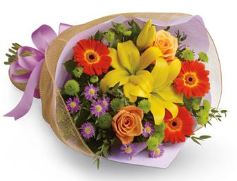 Bright Lights. Description: A burst of brilliant flowers designed to make their spirits soar! This spectacularly colourful bouquet includes lilies, gerberas and roses.
