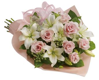 Pinking of You. Description: Stunning in its simplicity, this innocent harmony of roses and lilies are a heartfelt way to send your very best.