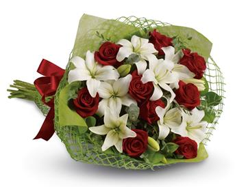 Royal Romance. Description: Add some romance with this rich bouquet of luxurious red roses and white lilies.