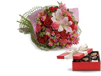 From the Heart. Description: Tell someone you love them with this romantic bouquet which includes roses, lilies, alstroemeria and carnations.
