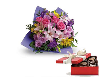 Love and Laughter. Description: Contemporary yet classic, this bouquet includes an elegant mix of roses, lilies and alstroemeria.