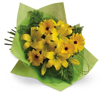 Sunny Spot. Description: Pure sunshine! Send sunny thoughts to someone special with this bouquet of warm yellow lilies and bright gerberas.