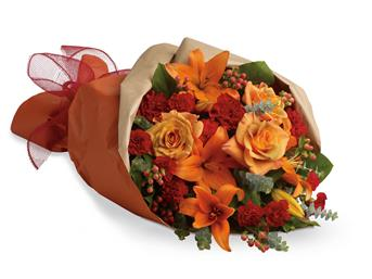 Sunset Dreams. Description: Beautiful and breathtaking as a sunset. This bouquet contains lilies, roses and mini carnations in ravishing shades of oranges and reds.