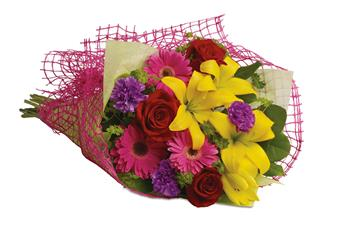 Fun in the Sun. Description: Let the sun shine in with this exuberant bouquet of golden lilies, rich red roses and hot pink gerberas.