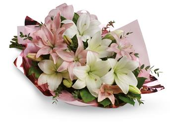 Lovely Lilies. Description: Stunning in its simplicity, this innocent harmony of light pink roses and snow white lilies are a heartfelt way to send your very best.