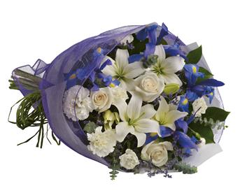 Twilight. Description: Capture the magic of twilight with this enchanting array of luxurious lilies, roses and iris.