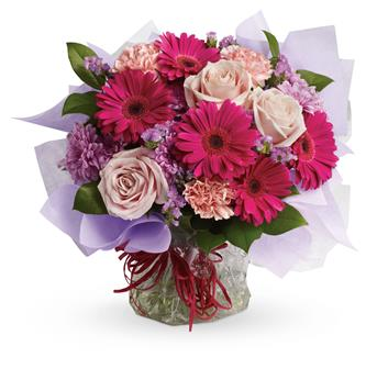 Sweet Dreams. Description: Treat them to a special surprise! Hot pink gerbera mix with pale pink roses and carnations in this delightfully delicious bouquet.