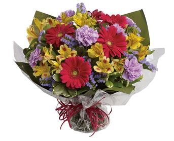 Sweet Surprise. Description: Unexpected gifts are the best gifts! Send one they will never forget with this sweet bouquet of hot pink, yellow and purple blooms.