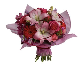 City Chic. Description: This stylish array of roses, lilies and gerberas makes yours a sophisticated statement of affection.