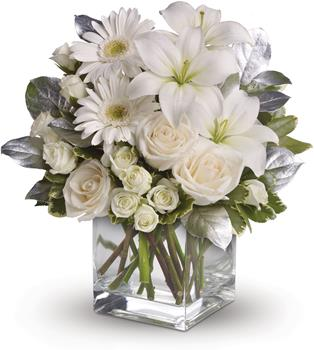 Shining Star. Description: You couldn not wish for a prettier or more dazzling arrangement of wonderful white blossoms. Striking ivory roses, white spray roses, gerberas, asiatic lilies, salal and pittosporum are lovingly arranged in a sparkling clear glass cube.