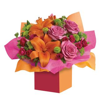 Make a Wish. Description: Want to make someones birthday really rosy? This is the perfect arrangement. Colourful roses, fun flowers all wrapped up in a box that has Birthday wishes written all over it!