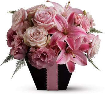 First Blush. Description: Searching for a floral arrangement that is fabulous and flirty? Look no further than this blushing arrangement, created entirely from blossoms in pretty shades of pink and accented with a pink satin ribbon.