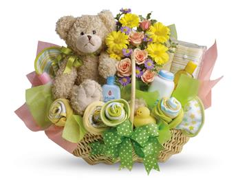New Baby. Description: Lucky bear! Make the new parents smile with this charming basket filled with flowers, assorted baby care essentials and a gorgeous teddy bear. Accented with a green satin ribbon, this thoughtful basket is sure to bring joy!