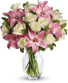 Always a Lady. Description: A romantic gift like this one is always appreciated. An eye catching display of roses and lilies is perfectly arranged in a clear vase which makes a beautiful and lasting impression.
