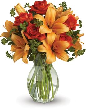 Fiery Beauty. Description: Spark someones attention by sending this absolutely radiant vase arrangement. Full of flowers and fiery beauty,it makes a beautiful gift for any occasion.