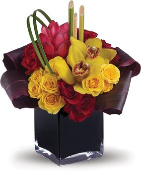 Island Daydreams. Description: Island dreams can come true no matter where you are. This arrangement beautifully combines tropical flowers with greens and hand-delivers them in a dramatic cube.