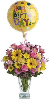 Dazzle Her. Description: Dazzle someone on their special day with a stunning vase arrangement. Delightful blossoms and balloon are sure to make their day!