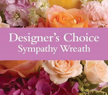 Sympathy Wreath. Description: Can not decide on what to send? The Designers Choice Sympathy Wreath is a one-of-a-kind collection of the designers freshest flowers.