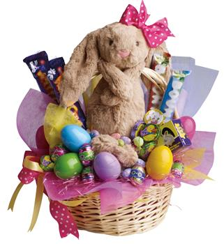 Easter Basket. Description: Be the Easter Bunny for someone special with this Easter basket full of chocolates and plush toy.
