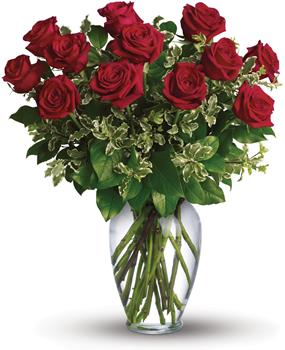 On My Mind. Description: Stunning in its simplicity, this elegant vase arrangement of deep red roses and rich green foliage makes quite an impression.
