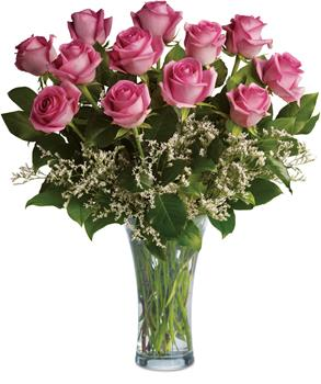Make a statement. Description: This lush arrangement of hot pink roses and greenery can be a fabulously romantic gift.