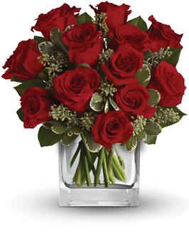 True Romance. Description: Turn up the heat on a new romance or a lifelong love affair with this classic cube arrangement of one dozen red roses.