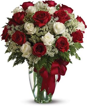 Love is Divine. Description: Loves divine, and roses are too. This beautiful vase arrangement of red and white roses is a timeless gift for your beloved.