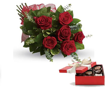 Fall in Love. Description: They will fall in love with you all over again when you surprise them with this perfectly petite bouquet of six sensational roses amidst beautiful fresh greens.
