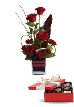 Rose Romance. Description: Roses, the traditional flower of love, receive a modern twist in this imaginative arrangement, stylishly presented in a contemporary glass cube.
