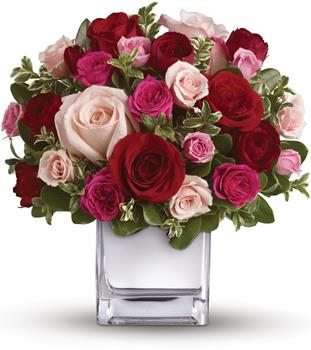 Lovely Melody. Description: Their heart will break into song when this romantic cube of ravishing roses arrive! A symphony of size and shade, this red and pink present will hold their heart forever.