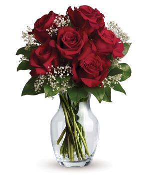 Hearts Delight. Description: What a delight! Six stunning roses put your love centre stage in this charming vase arrangement.