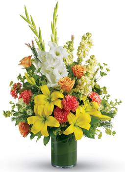 Fond Farewell. Description: Create a bright, heart-warming tribute to the special person who lit up everyones lives. Send a stunning leaf lined vase arrangement of golden lilies, white gladiolus and peach roses.