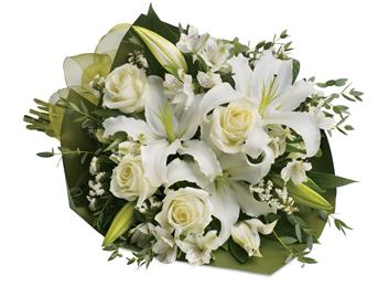 Simply White. Description: An elegant expression of sympathy, this wondrous white bouquet conveys purity and peace.