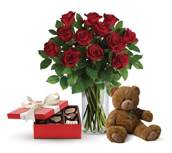 Beautiful Love. Description: This lavish gift set includes a gorgeous vase arrangement of twelve long stem red roses, accented with greenery, plus chocolates and a delightful bear.