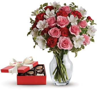 Eternal Love. Description: This charming gift set includes a delicious box of chocolates paired with a vase arrangement of light pink spray roses, red miniature carnations and white alstroemeria accented with assorted greenery.