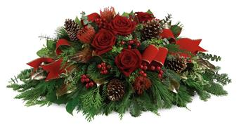 Christmas Glow. Description: Bring elegance to your Christmas table with this impressive table arrangement. Your guests will be dazzled!