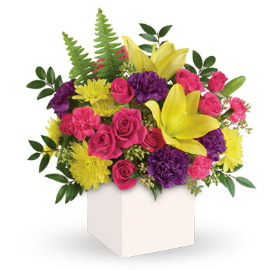 Vivid Delights. Description: Colour their day happy with this bright surprise! Artfully arranged, this sunny bouquet of yellow lilies and hot pink roses celebrates them in style.