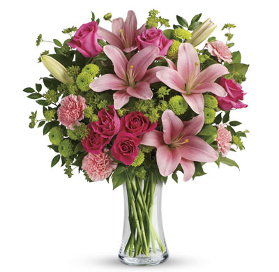 Junoesque. Description: What's better than pink? More pink! Lavish your loved one with this blissful bouquet of roses and lilies, hand-delivered in a classic glass vase. It's an impressive gift that promises to put some pink in her cheeks!